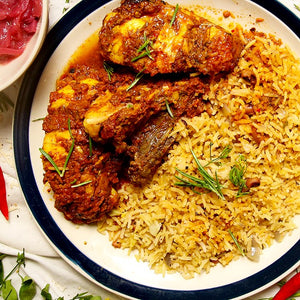 Oven-roasted Jerk chicken with rice & peas