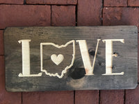 Love wooden sign with O shaped in the state of Ohio
