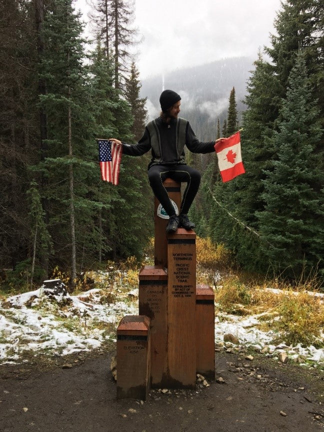 Mark Via reaches the Canadian border on the PCT – heavy duty bungee cords like SuperBungee really help make a hike like Mark's to be a successful experience!