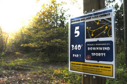 Hole 5 of the Powdermill disc golf course in Marquette sponsored by Down Wind Sports