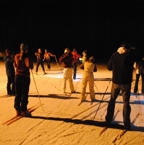 Group cross country skiing at night in the U.P.