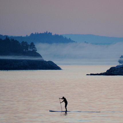 Stand up paddling on a foggy Lake Superior morning