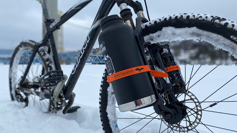 Klean Kanteen beer growler strapped to the fork of a Giant bike with a Down Wind Sports custom Voile strap