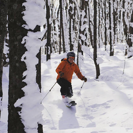 Bill Thompson skiing the trees on a beautiful Upper Peninsula winter day