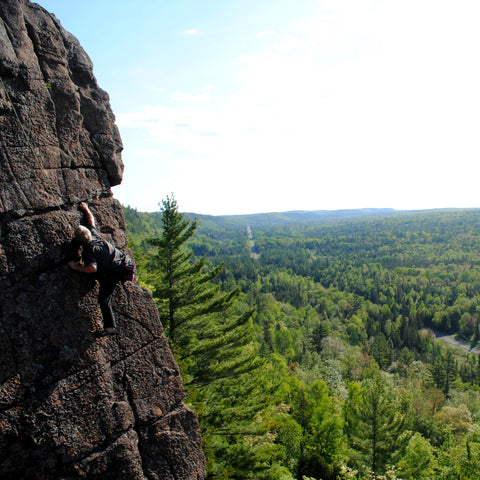 Store owner Arni Ronis climbs the classic JC Superstar at Cliff Drive in the Keweenaw