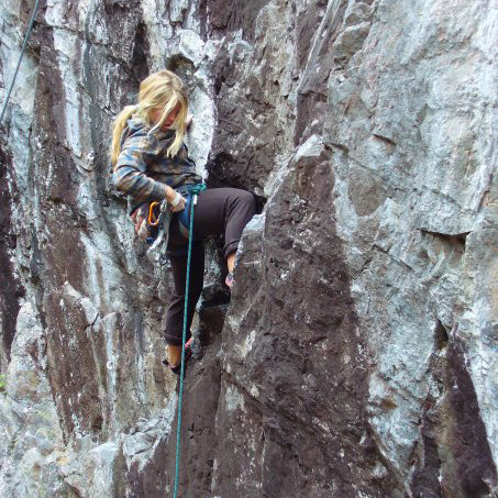 A female climber leads one of the many climbs in the Marquette area