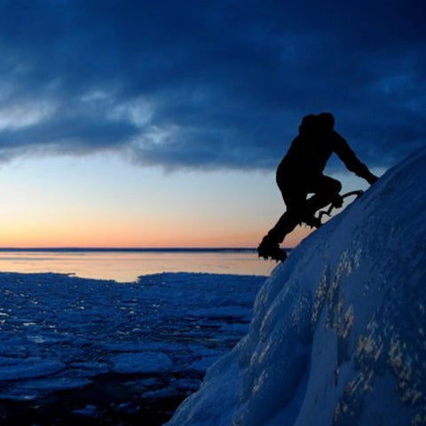 Down Wind Sports owner Bill Thompson getting a sunset ice climb in near Marquette