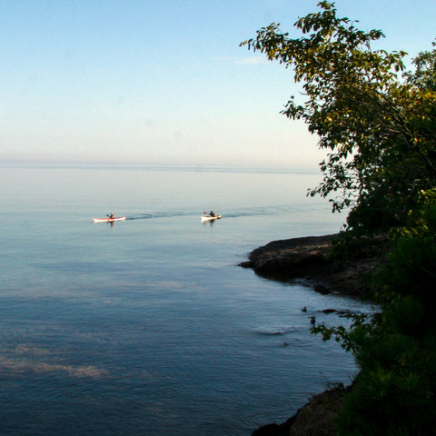 Two Kayakers paddling around Presque Isle in Marquette