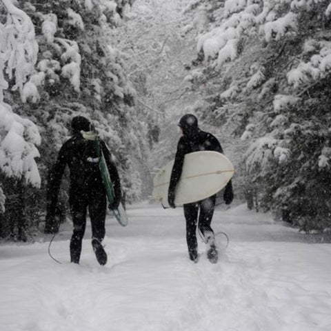 Walking to the surf through the snow in the Upper Peninsula