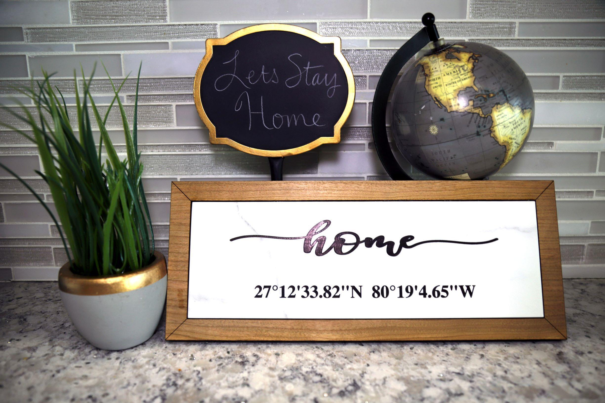 Home With Coordinates Sign