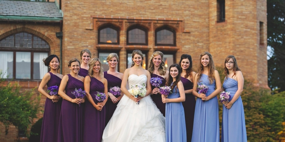 a beautiful photo of the bride and bridesmaids with their flower arrangements