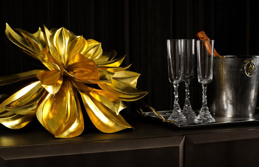 A stunning golden magnolia next to three champagne glasses