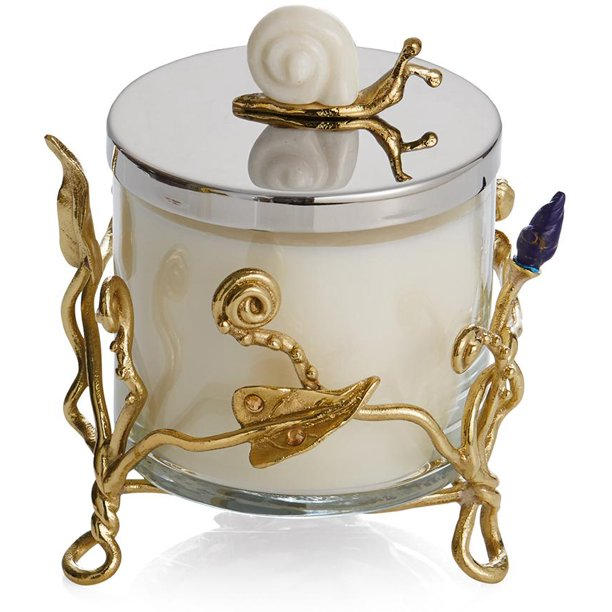 A beautiful aromatic candle set on a cage made of metallic golden branches, and a golden snail on the lid
