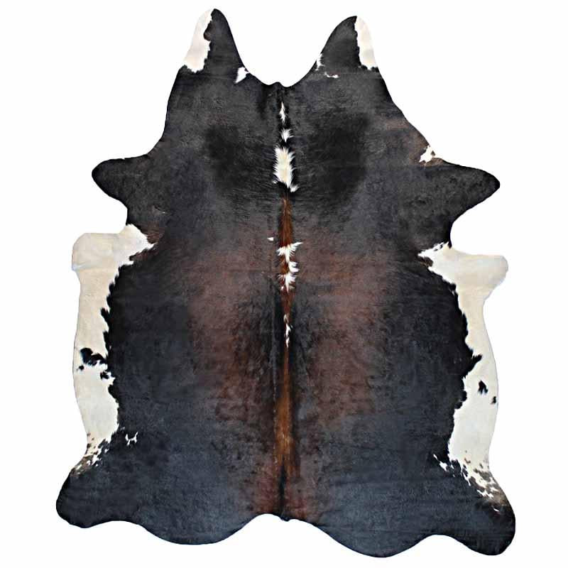 A Cowhide Rug in Black, Brown, and White - One of a Kind