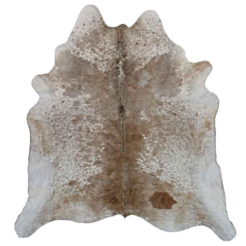A Cowhide Rug in a Tan & White Natural Color