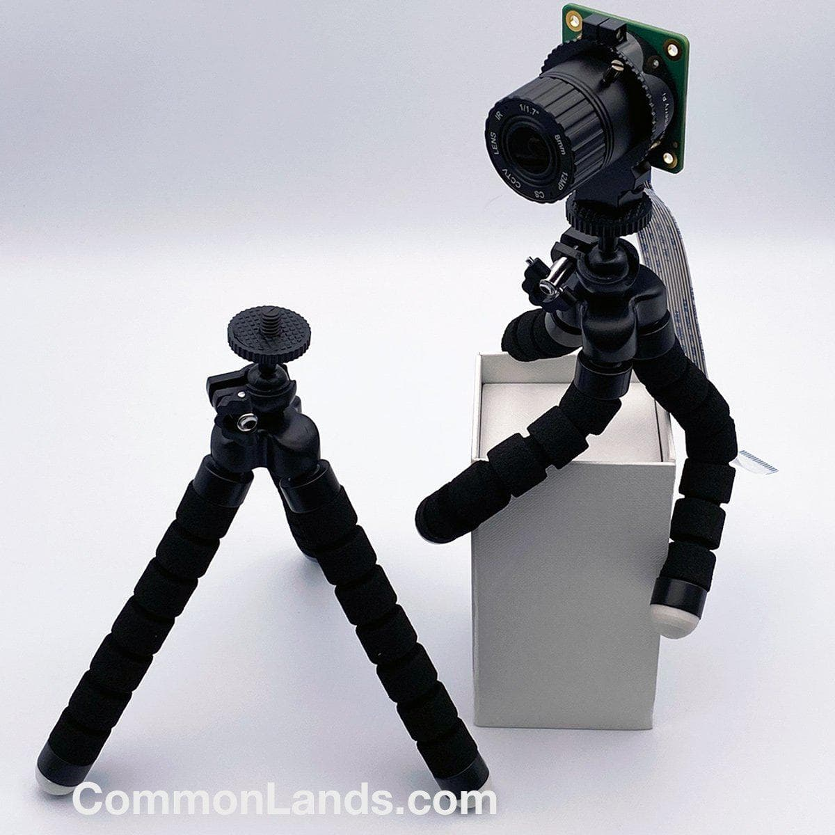 A versatile camera mounting tripod pictured on top of a box.