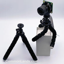 Load image into Gallery viewer, A versatile camera mounting tripod pictured on top of a box.