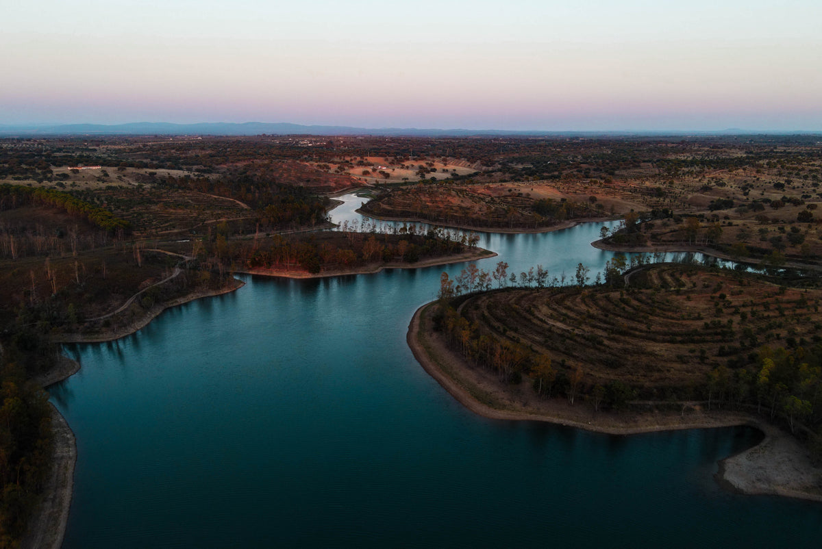 Lake in Alentejo where the Alba Yoga video was produced. The place is called Serpa and is very famous for all the cork oak trees around. The perfect spot for the Alba Yoga team to connect with nature.. The photo stands for the sustainable Alba Yoga store.