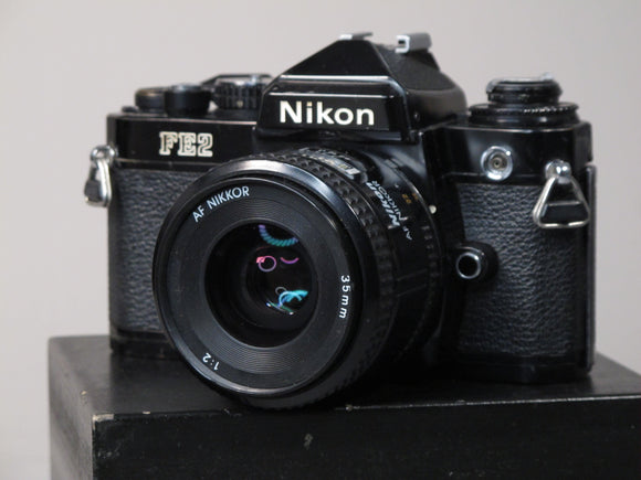 Black Nikon FE2 35mm Camera with Nikon AF 50mm f2 Lens