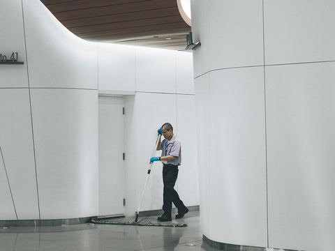 An image of a person cleaning a commercial building.
