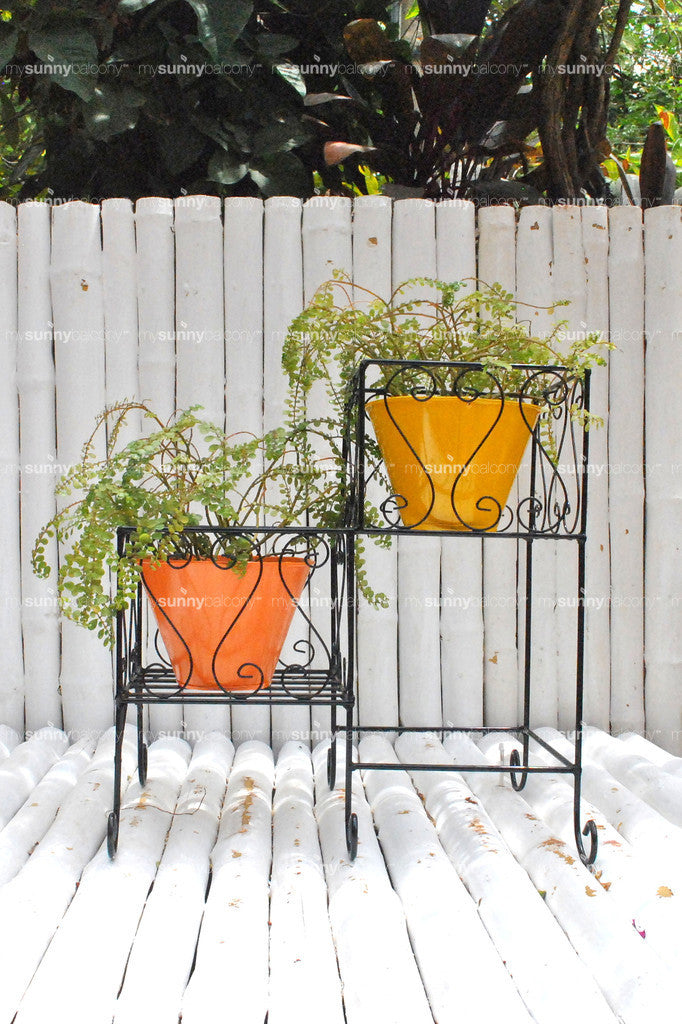 Wrought Iron two-tiered planter stand with metal filler pots