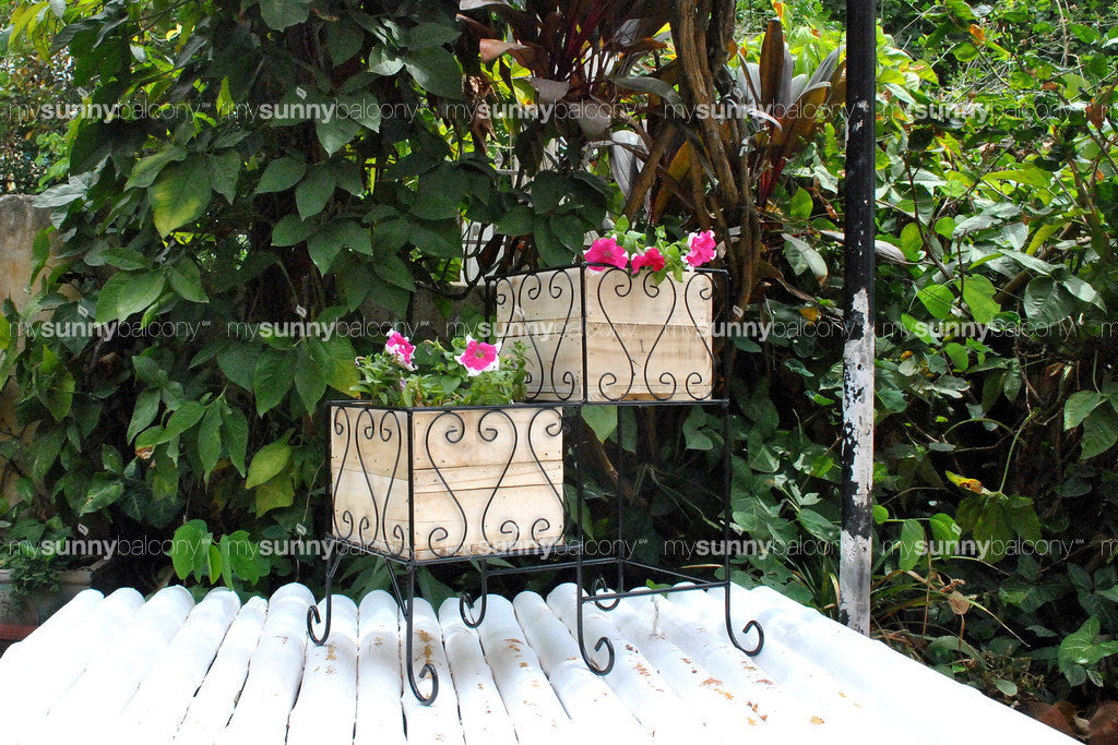 Wrought Iron two-tiered planter stand with wooden filler boxes