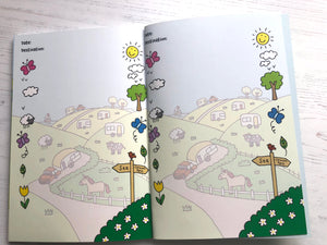 The inside pages where you can write about your adventures.  These pages have an exclusive design on them but it is feint so you can write on the top of it.  The feint illustration shows a car and caravan passing a field with a horse in it and down each side of the page are small fun elements of flowers, sheep, butterflies and leaves.  A signpost points to the Sea and to the Camp SIte.
