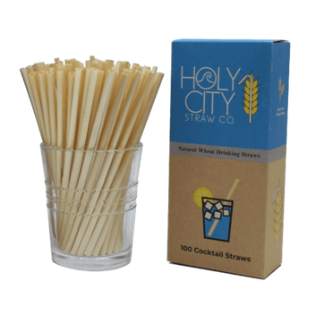 100 count box of Holy City Straw Company cocktail wheat straws next to a cup of straws