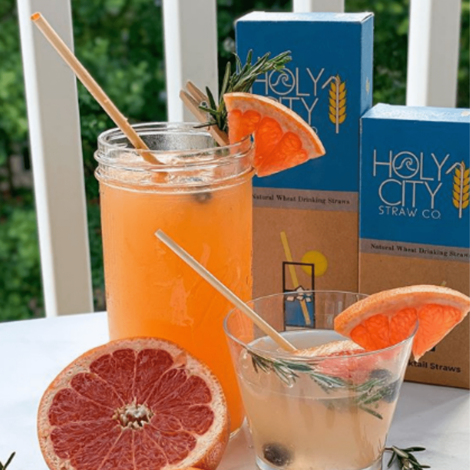 Tall and Short Cocktail alongside a tall and cocktail 100 count boxes of Holy City Straw Company wheat straws