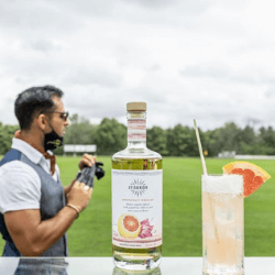 The-Cup-Bearer-displaying-a-cocktail-on-a-polo-field