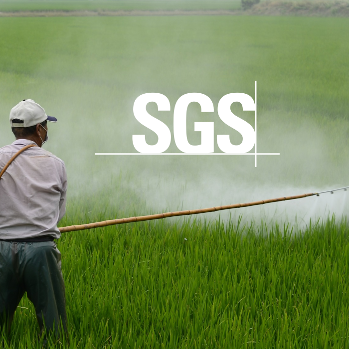 SGS logo overlay-ed a worker fertilizing a field of green plants.