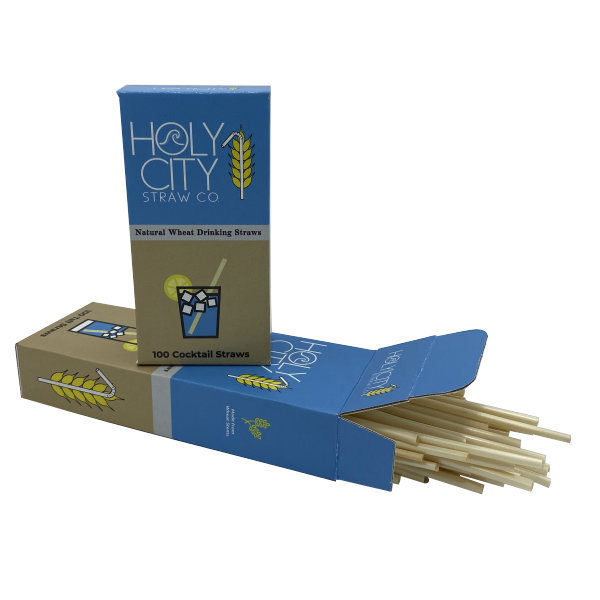 Open box of 100 count Holy City Straw Company tall wheat straws with straws coming out the opening along with a 100 count box of cocktail straws on top of it.