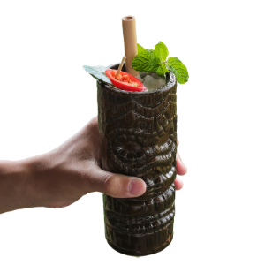 Hand holding a Frozen Drink with Reed Straw in it