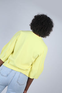 Yellow sharp seamed three quarter sleeve top_MCBBA1