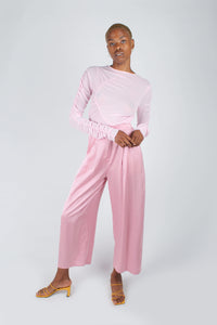 Pale pink satin tucked wide leg trousers_1