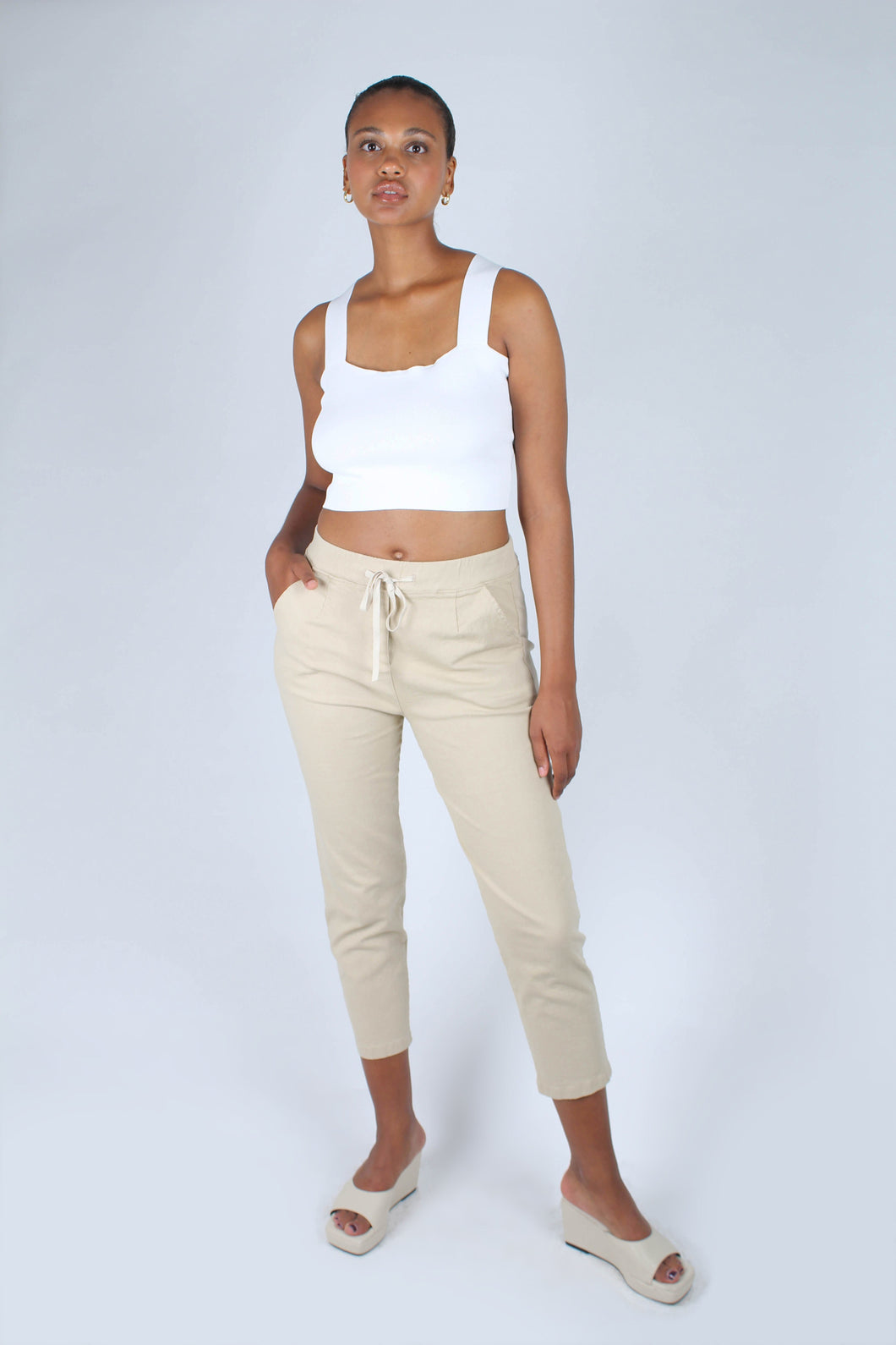 Beige dart front loose fit drawstring trousers_1