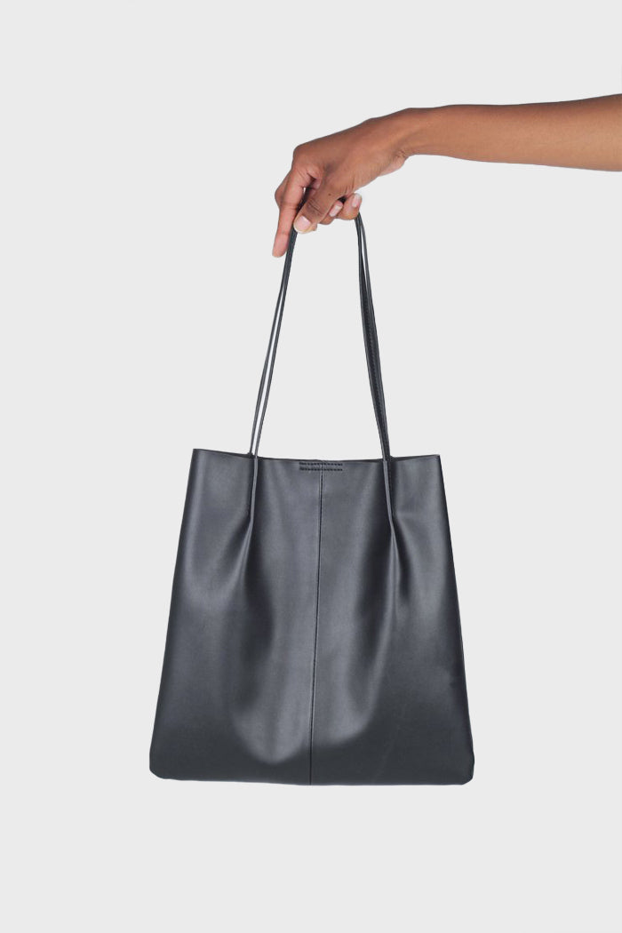 Black vegan leather pinched strap tote bag