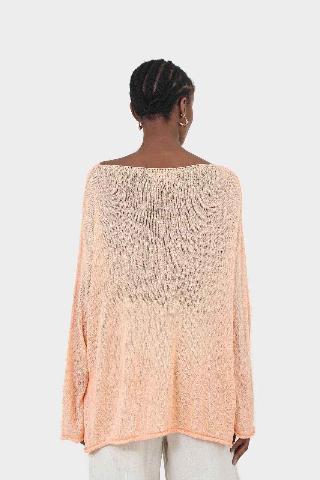Pale orange wide neck long sleeved loose knit top1