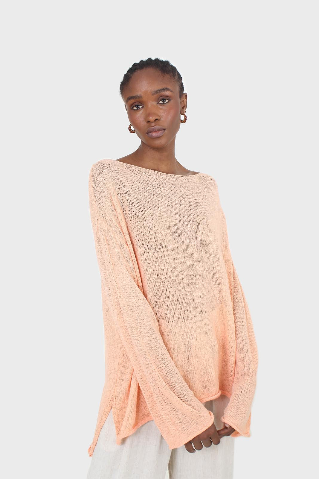 Pale orange wide neck long sleeved loose knit top3
