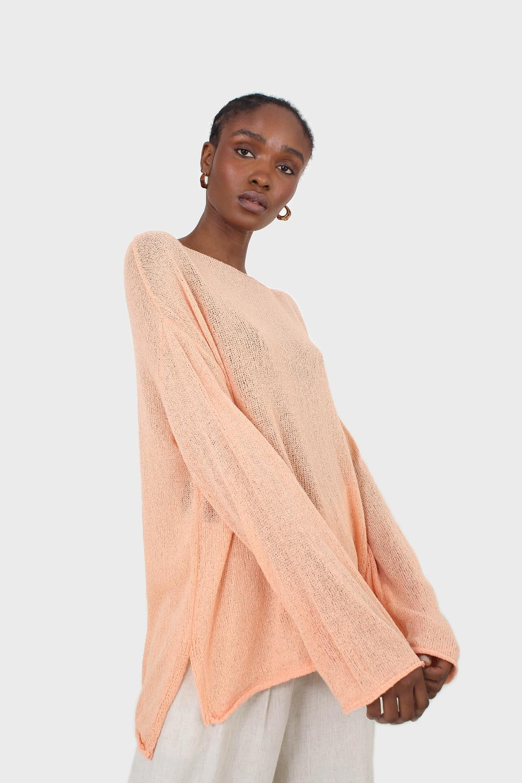 Pale orange wide neck long sleeved loose knit top4
