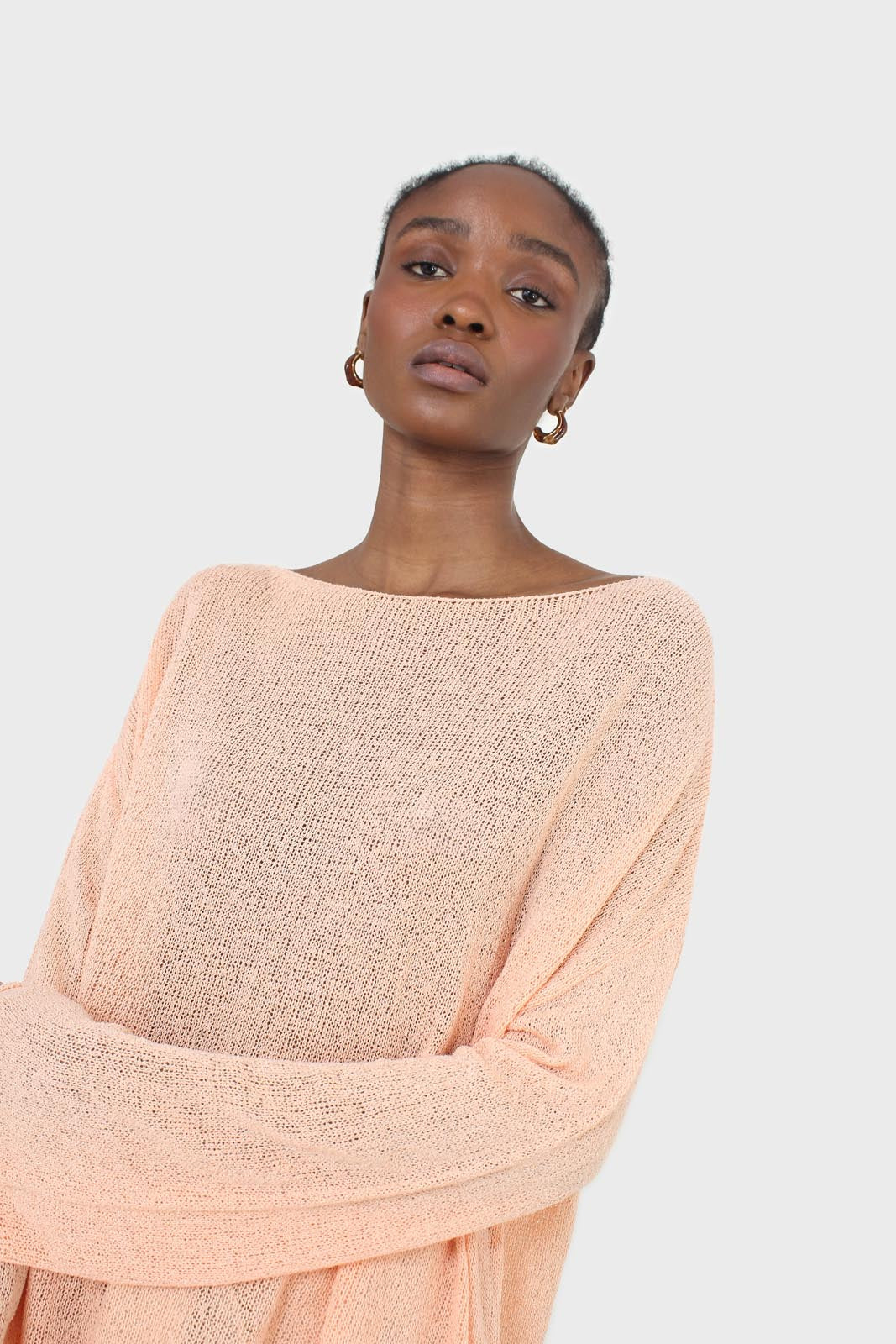 Pale orange wide neck long sleeved loose knit top5