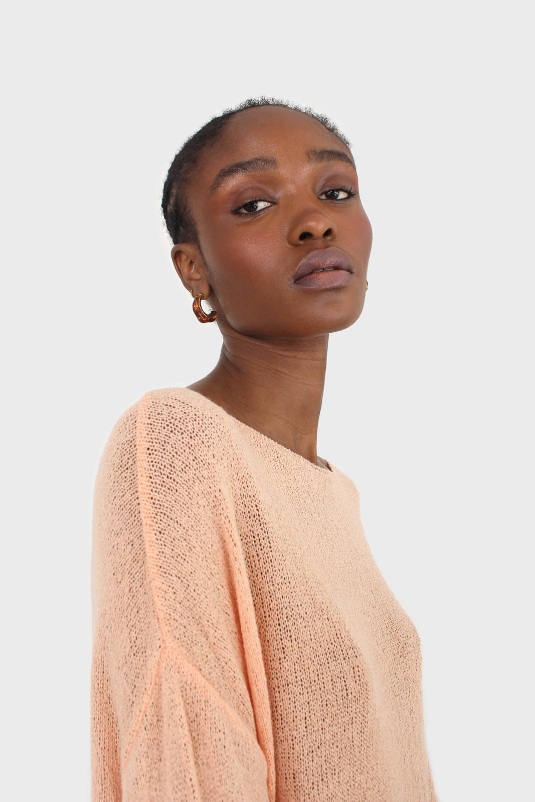 Pale orange wide neck long sleeved loose knit top6