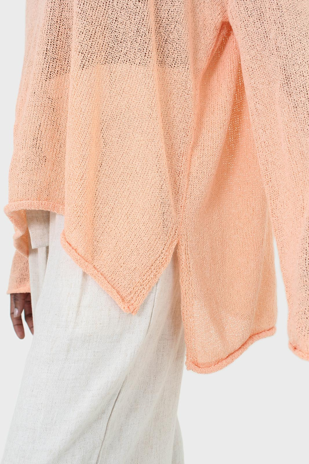 Pale orange wide neck long sleeved loose knit top7