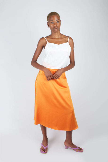 Orange silky flare front pocket midi skirt_1