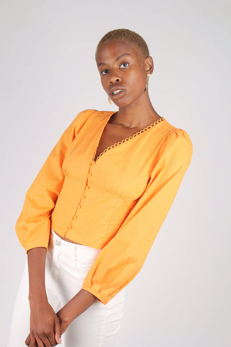 Orange button front crochet trim wide hem top_1