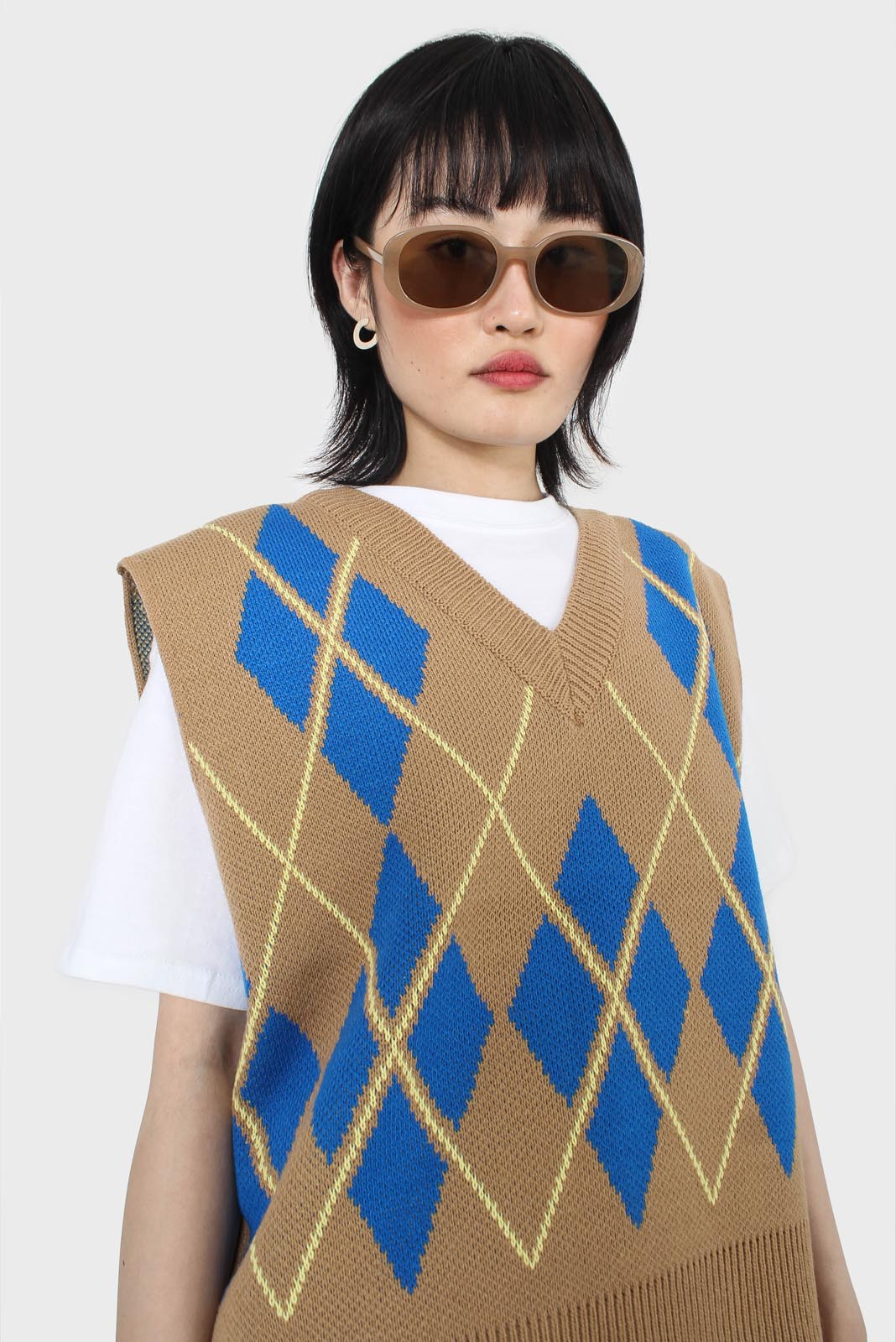 Camel and bright blue argyle sweater vest1