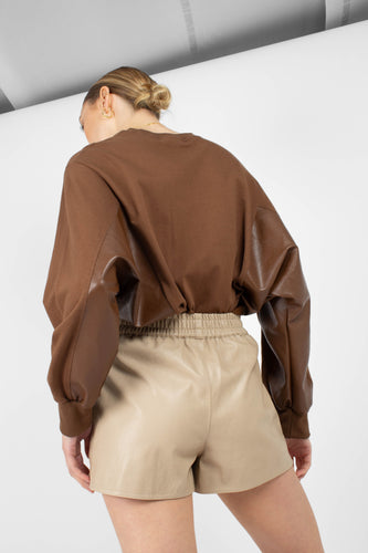 Beige vegan leather running shorts3