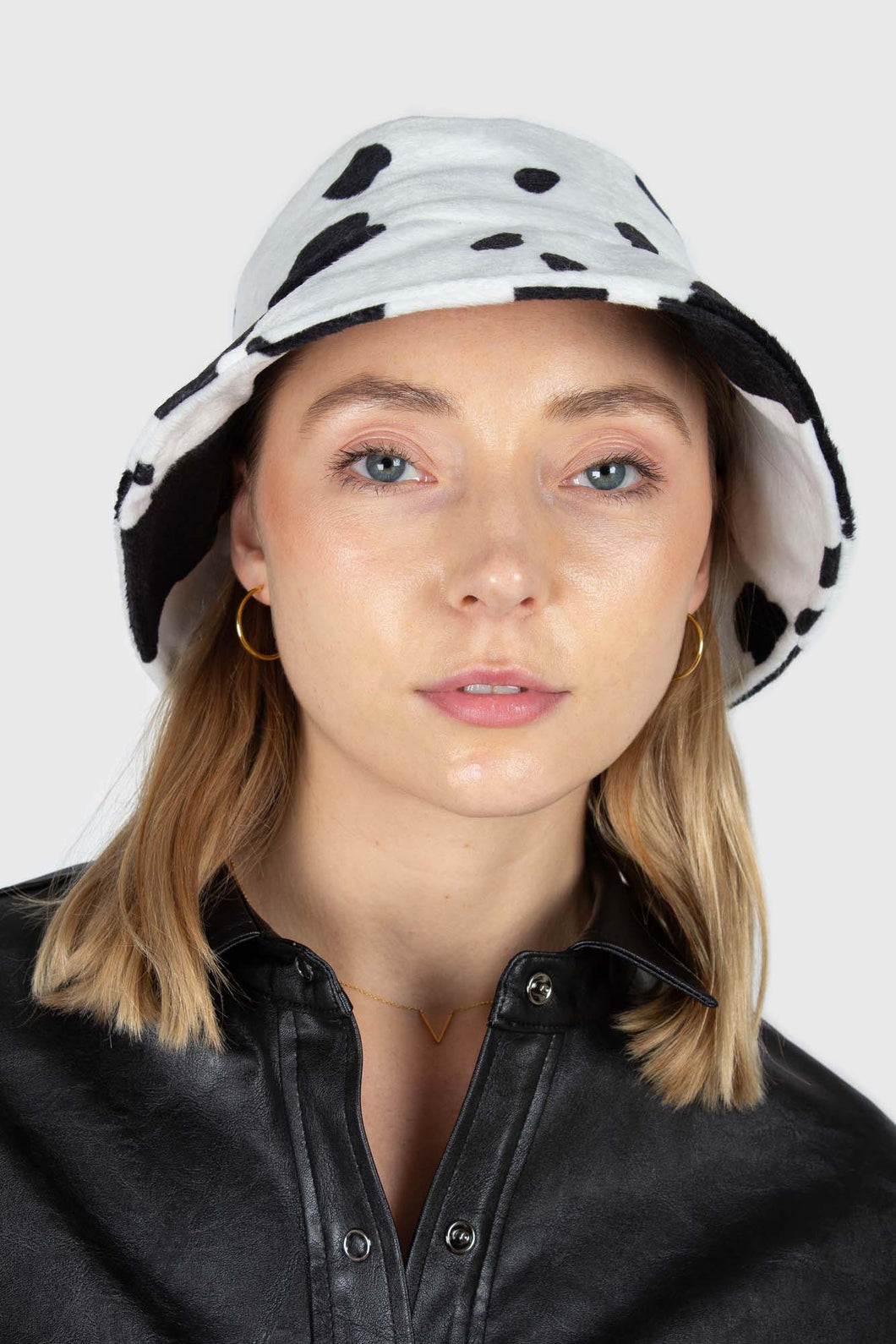 White and black cow print bucket hat1