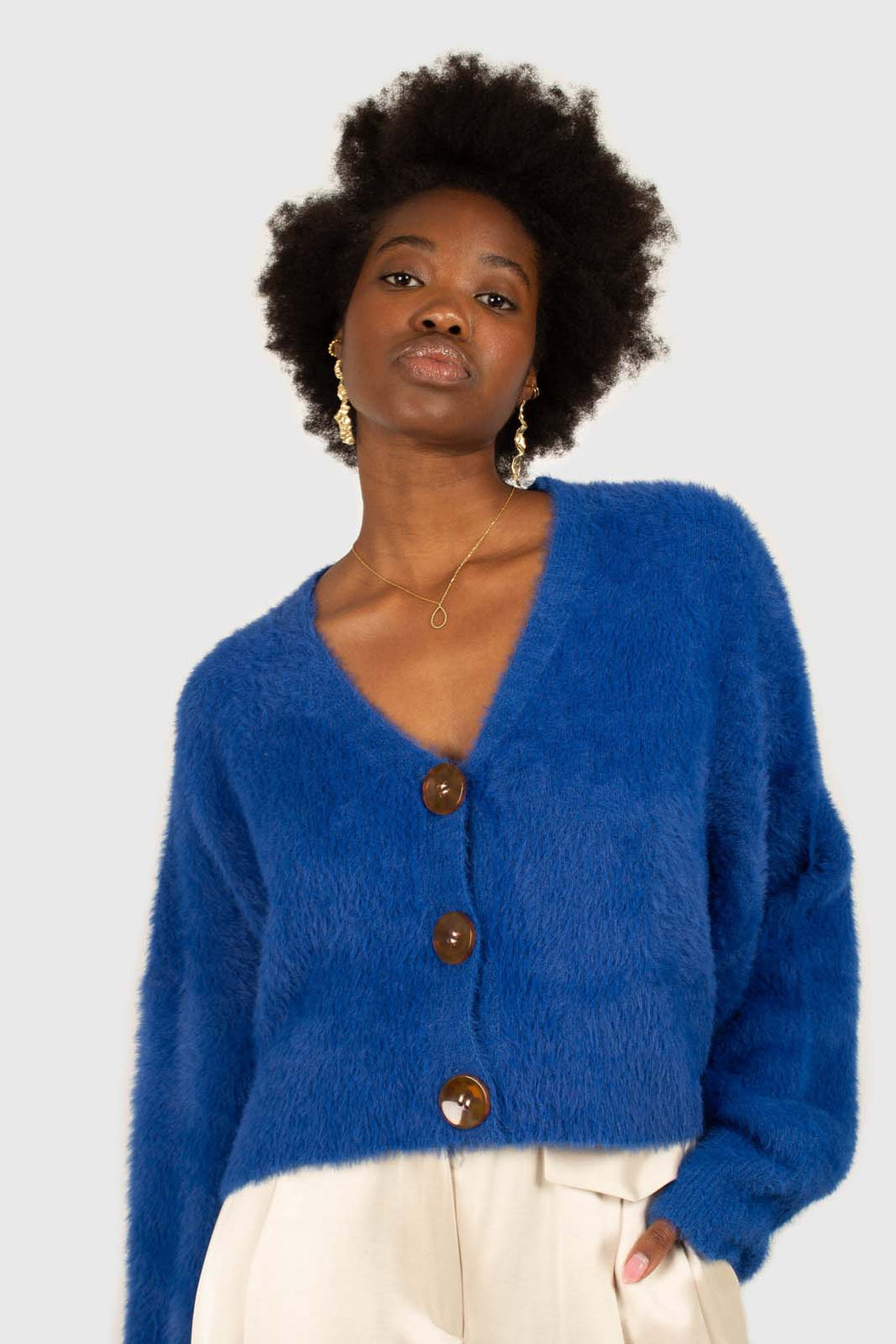 Bright blue fuzzy tortoise shell button cardigan1