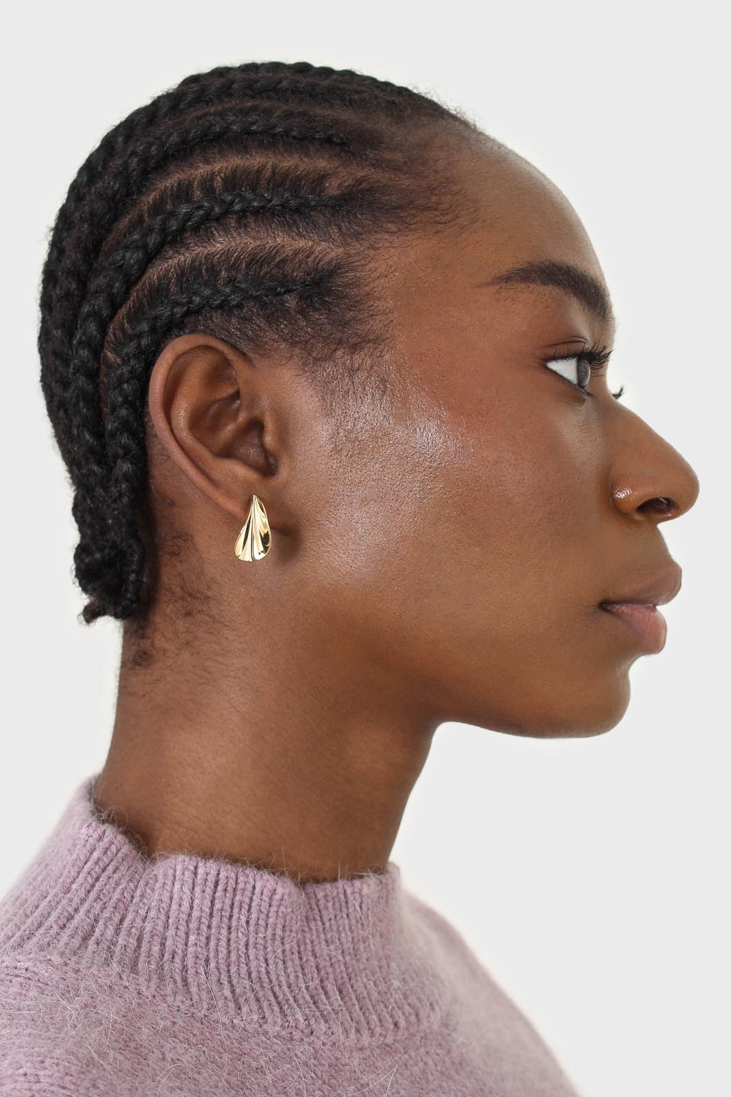 Gold pinched stud earrings1